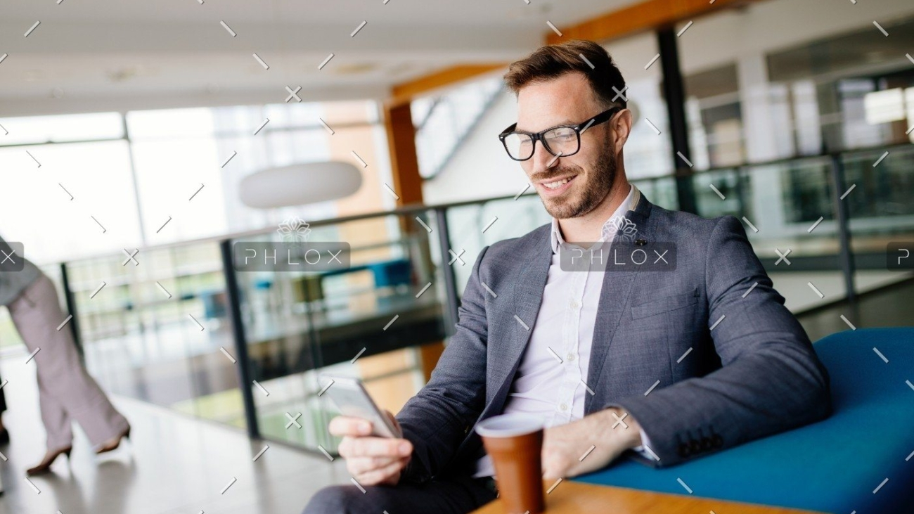 demo-attachment-1475-businessman-taking-a-break-with-a-cup-of-coffee-JW4B3DH